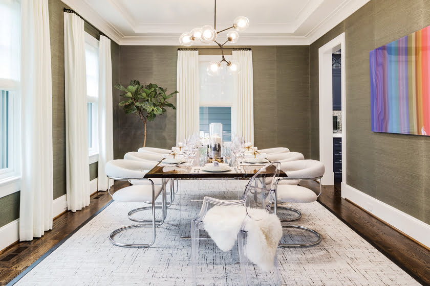 In the dining room, Elizabeth Spratt Cooper combined Phillip Jeffries wall covering and a reproduction Lindsey Adelman chandelier with a contemporary edge.
