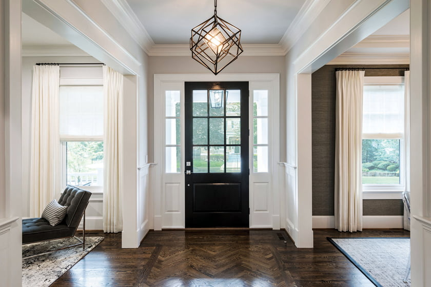 A herringbone inlay in the dark-stained oak floor defines the foyer.