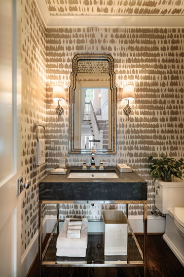 Schumacher wallpaper enlivens the powder room.