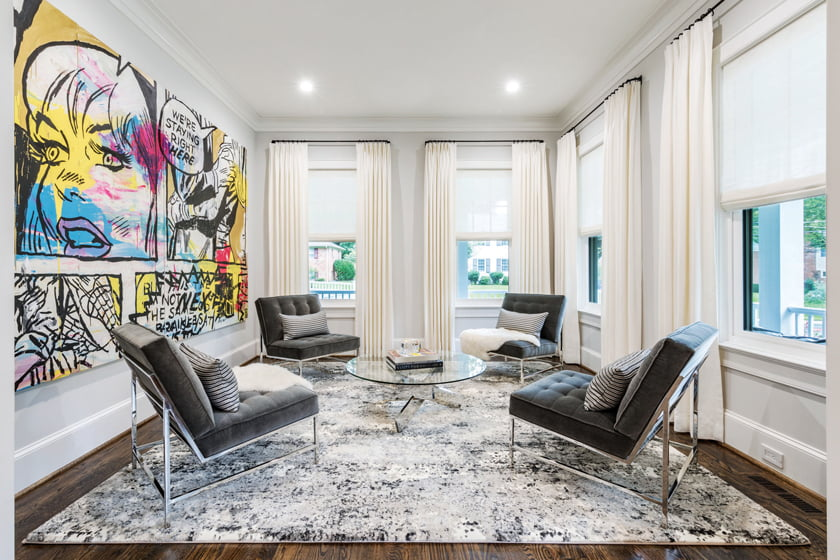 Cooper opted for few furnishings in the small living room to emphasize the bold painting by street artist KeyHan.