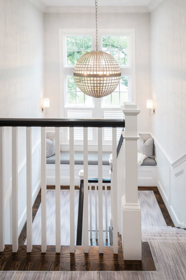 Cooper selected a large-scale light fixture by Visual Comfort for the main staircase.