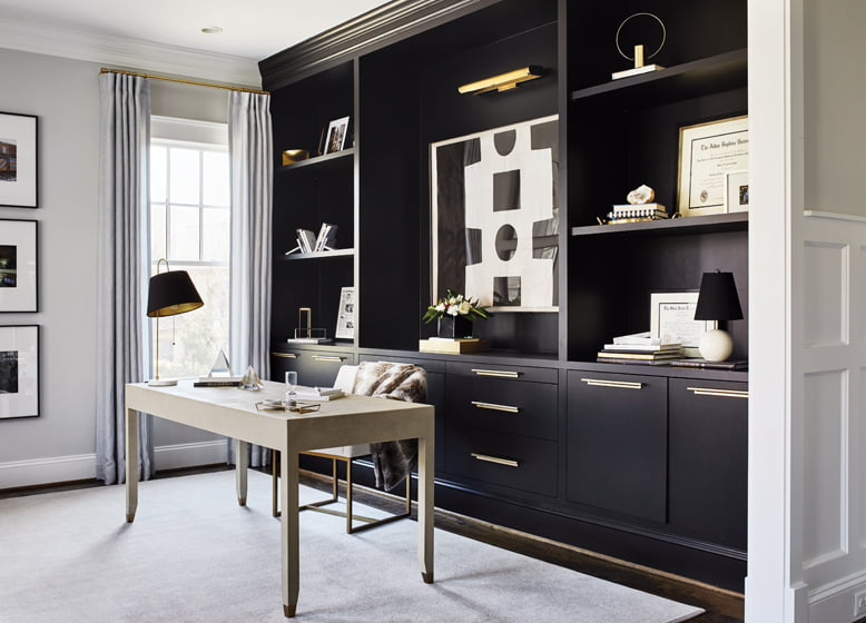 On one wall of the study, Abizaid added built-ins in sleek matte black.
