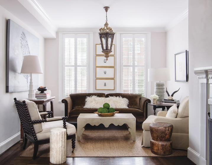 A Bernhardt sofa in Duralee velvet anchors the front-parlor seating area, flanked by a Chinese stool and a Thai column.