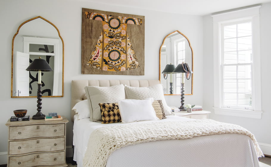 Wisteria chests double as nightstands in the master bedroom, embellished by a wall hanging Riddell acquired in Istanbul.