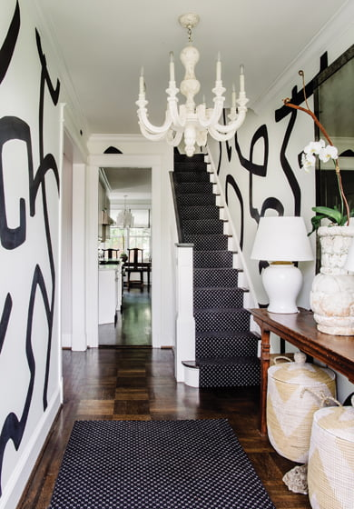 Artist Deborah Weir painted the foyer walls in a bold, graphic pattern.
