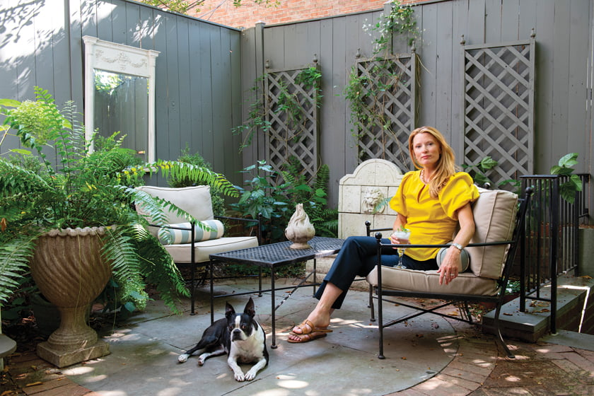 Colman Riddell relaxes on the rear terrace with her dog, Pim.  © Michael Ventura.