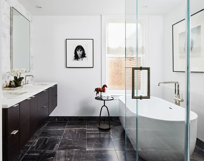 In the renovated master bath, a Maplethorpe portrait of Patti Smith takes center stage.
