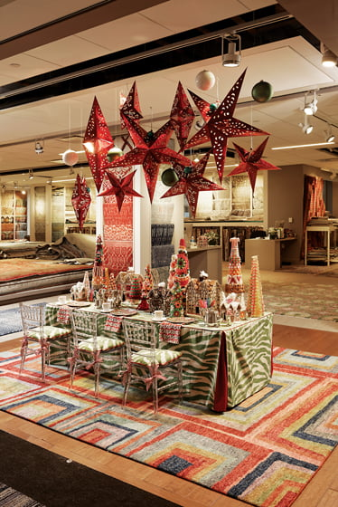 Last year, SCW Interiors created a tabletop display of gingerbread and candy in Galleria Carpets. © Bob Narod