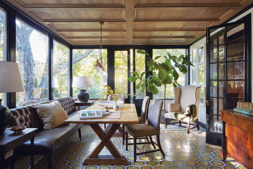 In the sunroom, Ann Sacks concrete tile paves the floor and a Lee Industries sofa serves as a banquette.