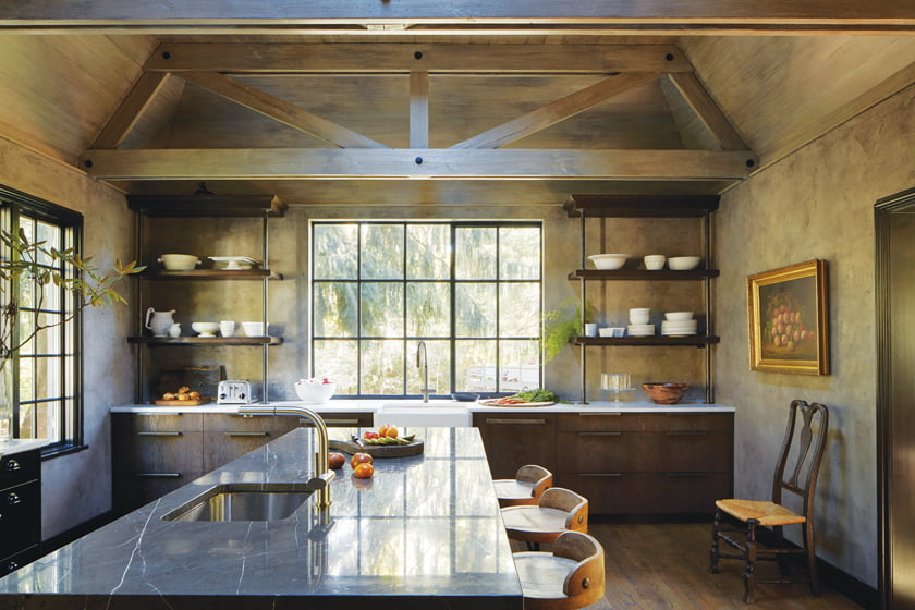 The kitchen's concrete-wash walls and faux-bois ceiling and truss finishes were done by Artstar Custom Paintworks.