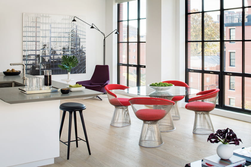 In the redo of an Arlington condo, the challenge was to work with the owner's modern art collection and add warmth.