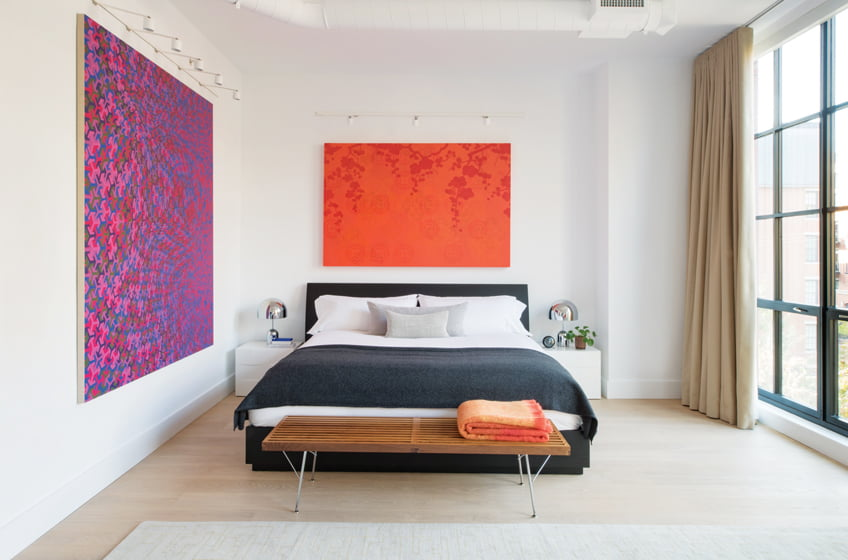 An acrylic-on-linen canvas by Anoka Faruqee is featured to the left of the bed.