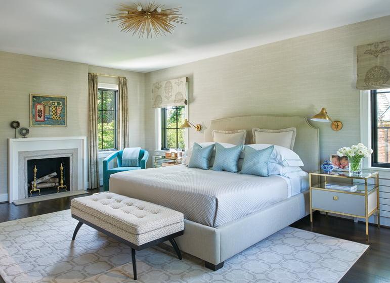 Ebert's serene master bedroom combines a custom bed, a Stark carpet and Century nightstands.
