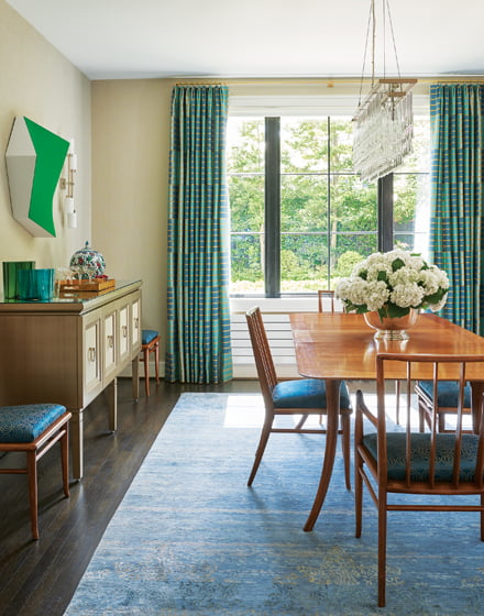 The dining room features a 1940s-era T.H. Robsjohn-Gibbings table and chairs.