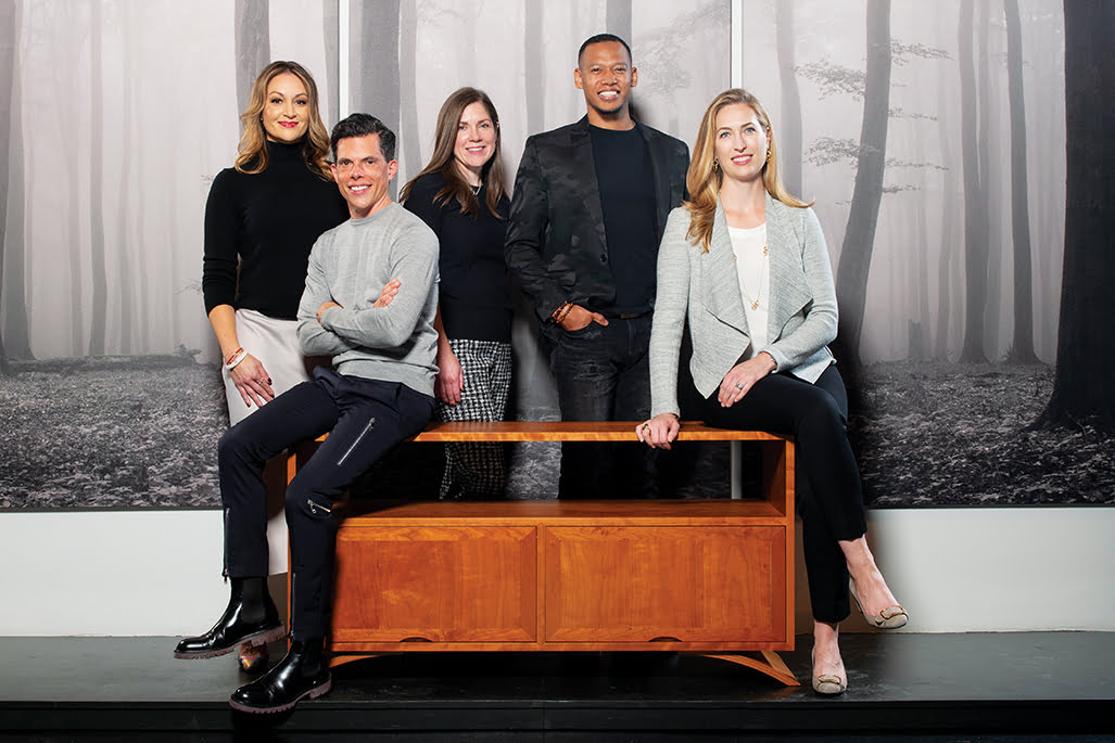 Sarita Simpson, Jason Claire, Melissa Sanabria, DuVäl Reynolds and Catherine Ebert, pictured left to right around a hand-crafted Thos. Moser Vita Credenza.