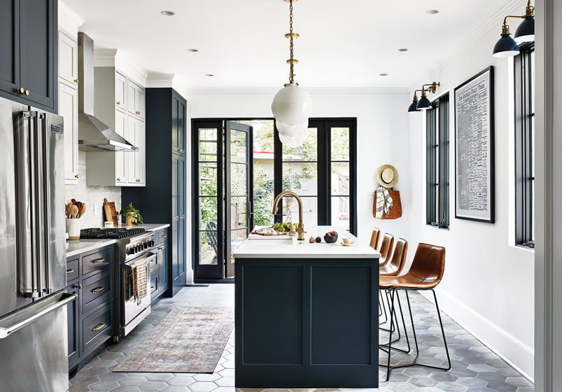A recent Capitol Hill project encompassed a kitchen addition with a Clé Tile backsplash and pendants from McGee & Co. by Marvin.