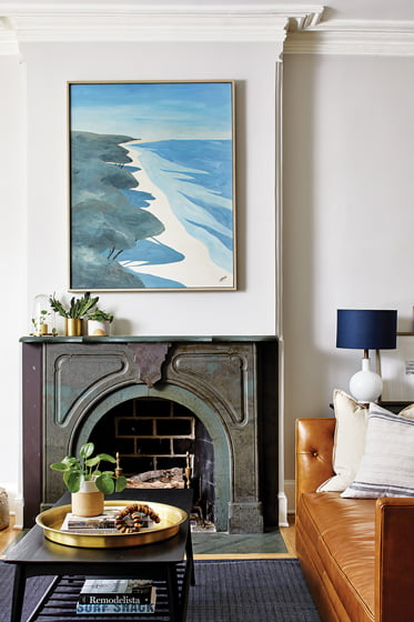 In the home's living room, the original Victorian fireplace was restored.