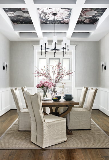 In the dining room, he embellished the ceiling in floral wall covering by Ellie Kashman. © Stacy Zarin Goldberg
