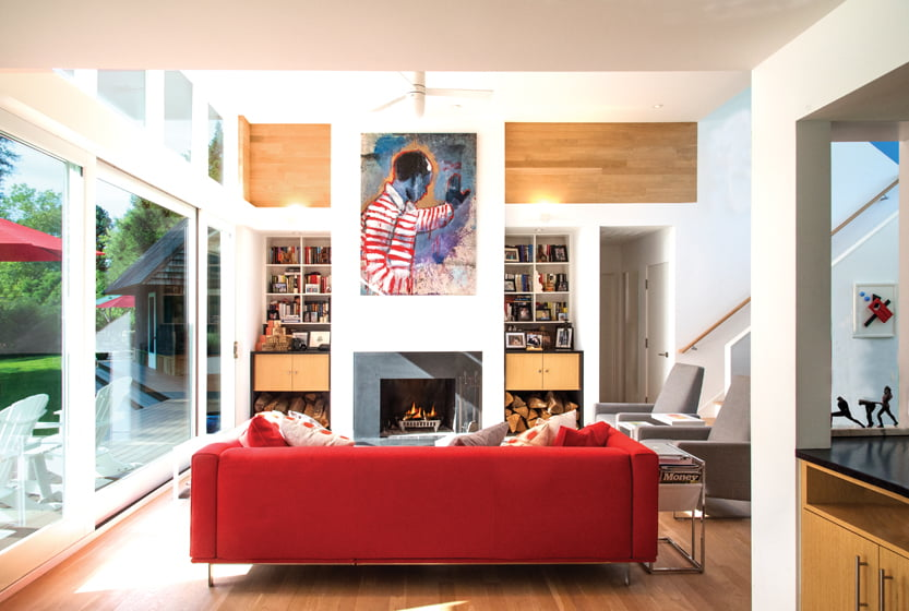 In the living area, McInturff raised the ceiling height and replaced the traditional fireplace with a sleek, modern one.