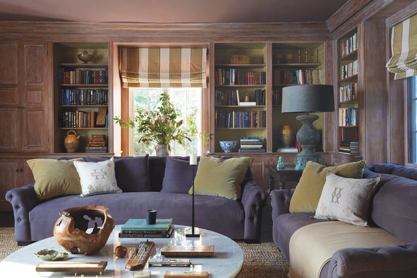 The family room features plush lavender sofas by Verellen around a Domicile coffee table by Bolier.