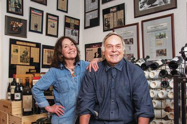 Inside their residence, Robert Parker, Jr., and wife Pat unpack wine in his former office.