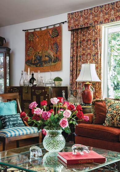 Fresh-cut roses grace the living room.