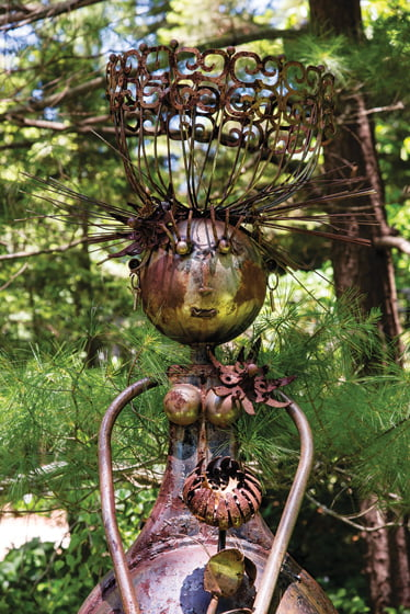 Whimsical outdoor sculptures, several of which were crafted with scrap metal, dot the property.