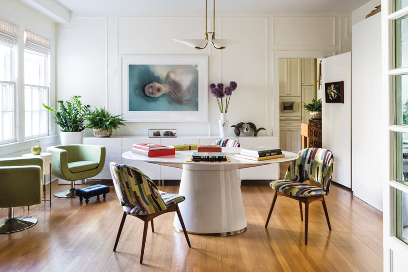 The dining room centers on a FlexMod table, vintage chairs in Scalamandré fabric and a photograph by Tamar Levine.