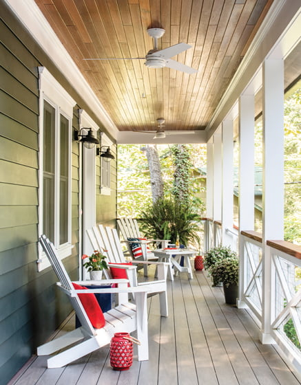 Adirondack chairs line the gracious front porch.