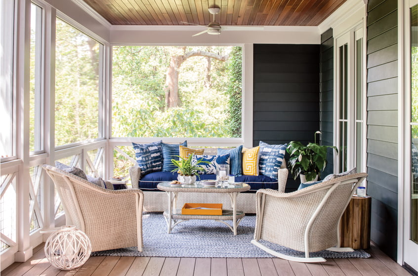 Lloyd Flanders wicker furniture offers seating on one side of the back porch.