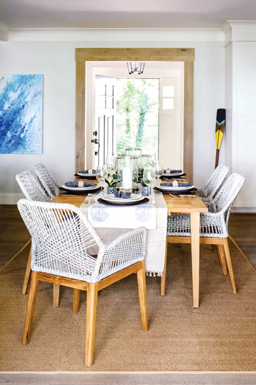 The teak dining table from Williams Sonoma is surrounded by Indonesian teak-and-rope chairs.