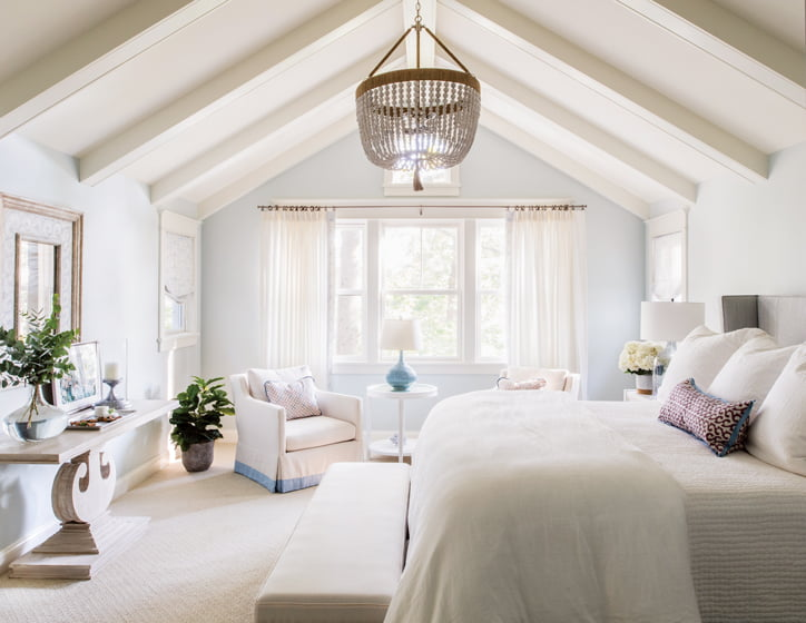 In the master bedroom, a beaded Ro Sham Beaux chandelier emphasizes the vaulted ceiling.
