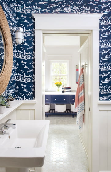 Serena & Lily wallpaper and a Shades of Light rope mirror add nautical touches to the kids' bathroom.