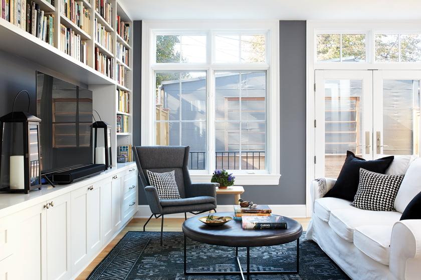 Energy-efficient Weather Shield windows from Quality Window & Door overlook the rear garden.