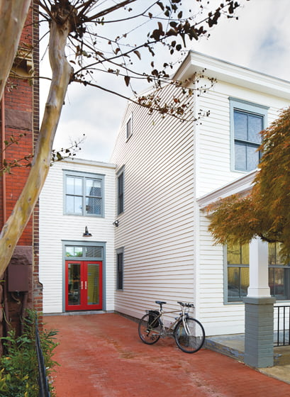 Architect Stephen Lawlor added a new entry hall onto the left of the existing row house.