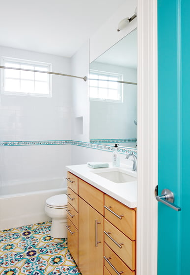 Colorful encaustic tile the owners discovered in Italy covers the hall-bathroom floor.