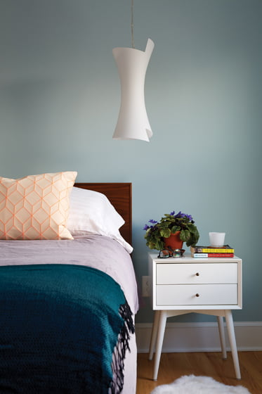 The master bedroom is painted serene Yarmouth Blue by Benjamin Moore.