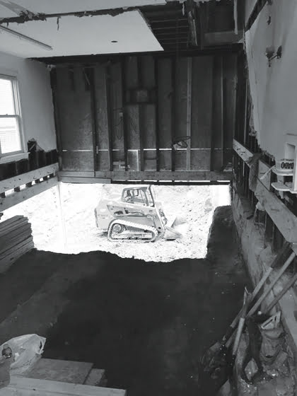 BEFORE: A construction shot documents the dramatic basement excavation.
