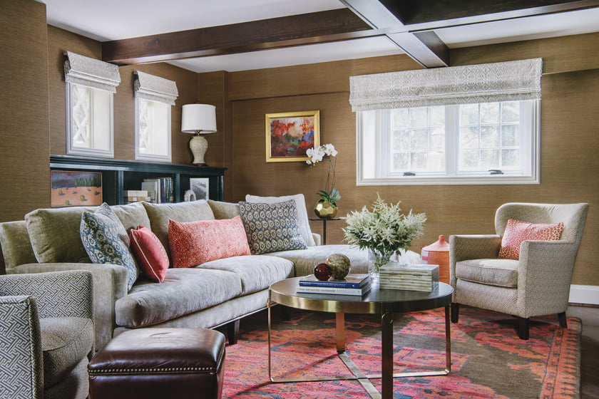 Owners and guests gather in the den on a Lee Industries sectional topped with custom pillows in Ralph Lauren fabric.