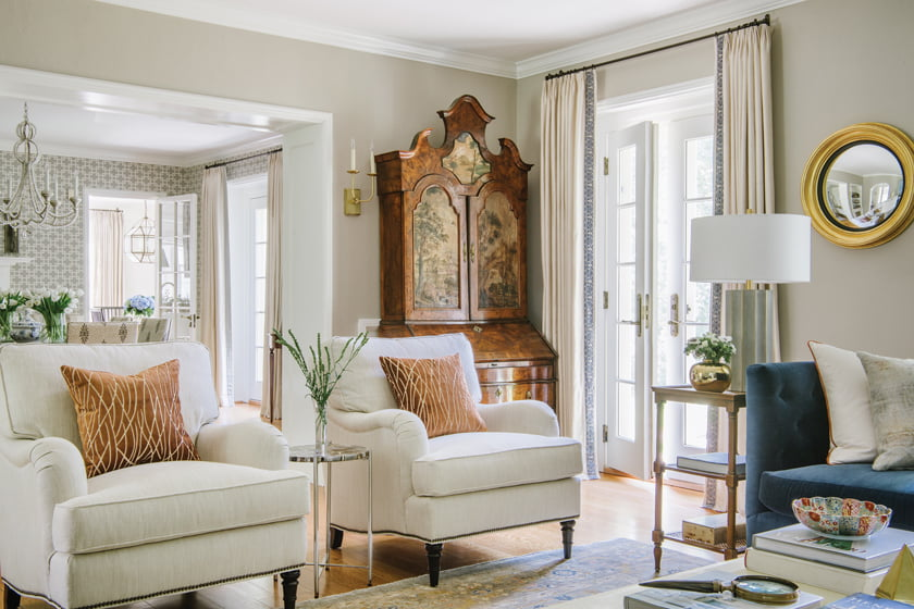 The living room is enhanced by an heirloom piece depicting pastoral scenes.