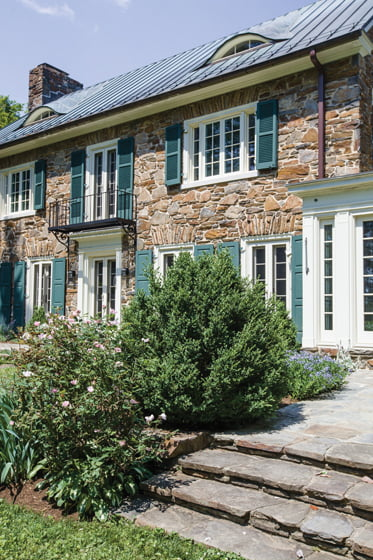 Clad in rustic stone, the home dates back to 1927. Photo: Jamie Sentz