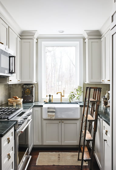 Contractor Aaron Daley's team handcrafted kitchen cabinets with Shaker-style doors.