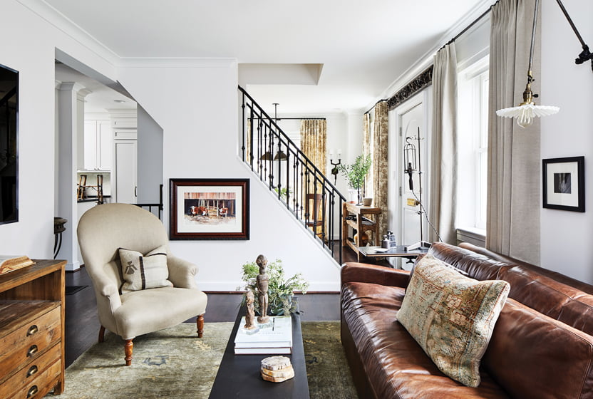 In the living room, Corrie mixed retail furnishings with rarified antiques, including an Oushak rug.