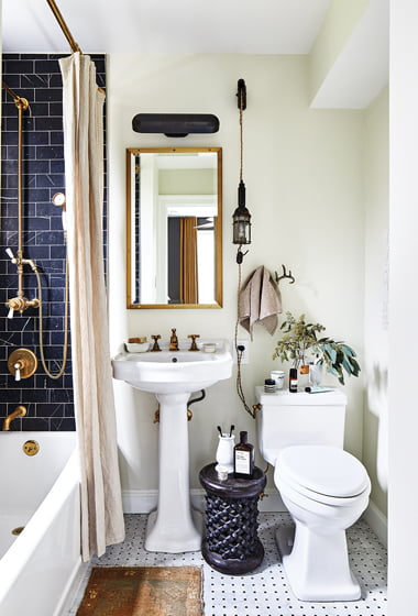 Vintage light fixtures in the guest bath add character and interest.