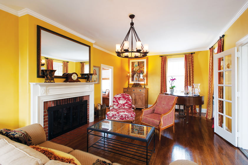 The living room is painted in Benjamin Moore's Stuart Gold to conjure a French Country feel.