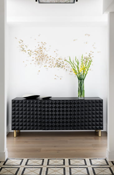 A console by Sabin and a ceramic installation by Christina Watka grace the entry.