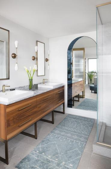 A custom walnut vanity is a focal point in the master bath.