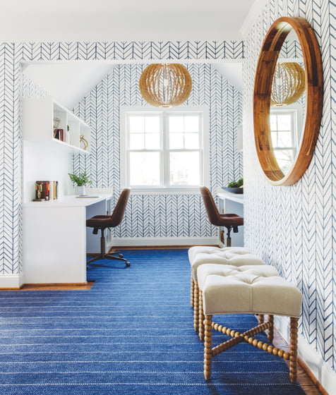 A new dormer created a kids' study lounge, covered in Serena & Lily wallpaper