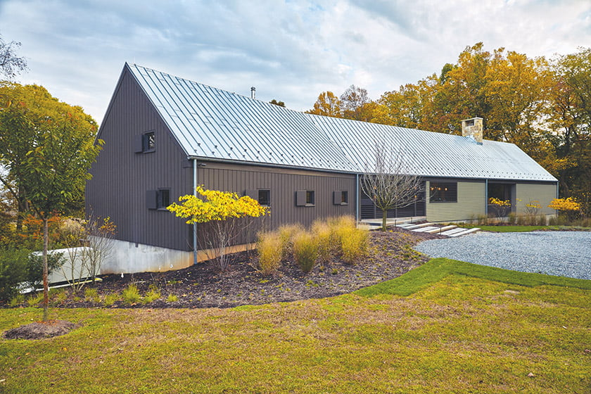 The house is clad in powder-coated aluminum and vertical mahogany siding with a galvanized-steel, standing-seam roof. The landscape was designed by Jordan Honeyman Landscape Architecture. Photos by Neill Roan