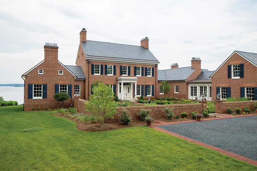 A custom brick home on the Severn River in Annapolis was designed by Neumann Lewis Buchanan and built by Winchester.